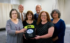 MHHS staff present Walters State with an AED