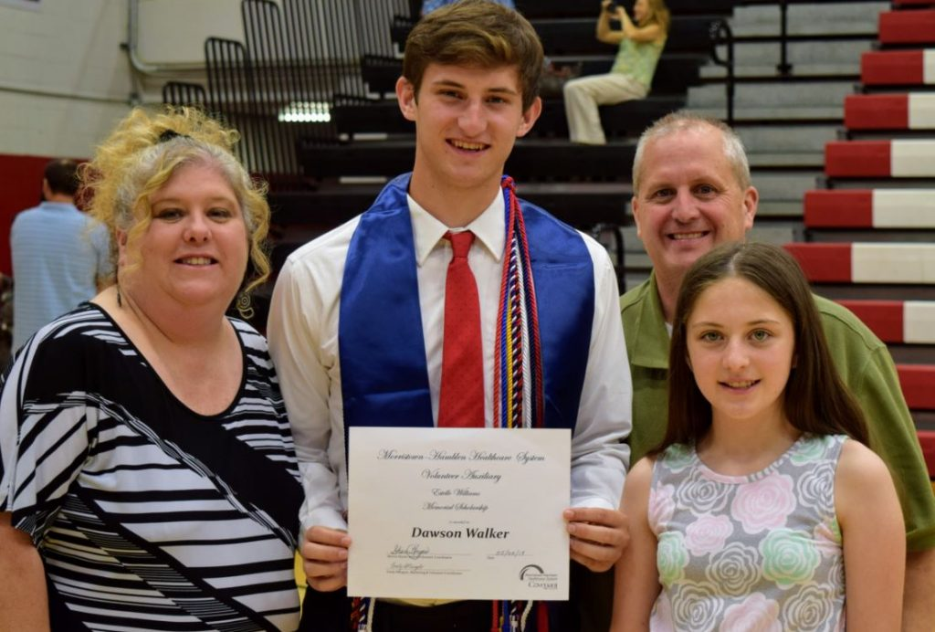 Dawson Walker with his family, receiving a scholarship.